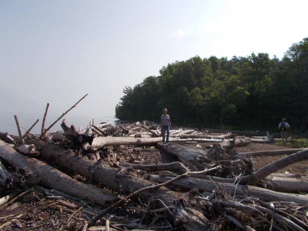 Me walking on driftwood near mouth of Presque Isle River, Porcupine Mountains Wilderness State Park, Michigan