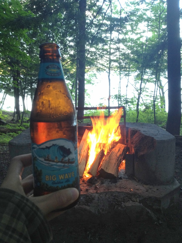 Having a beer and catching up around the fire, Moffitt Beach, New York