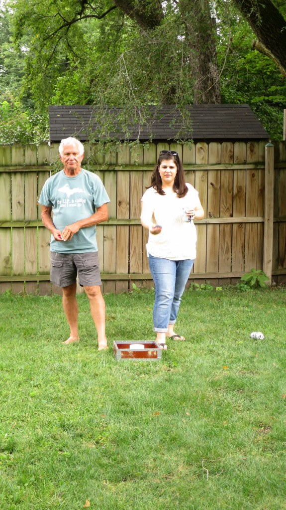 Tom and daughter Amy playing lawn games, Kansas City, Kansas
