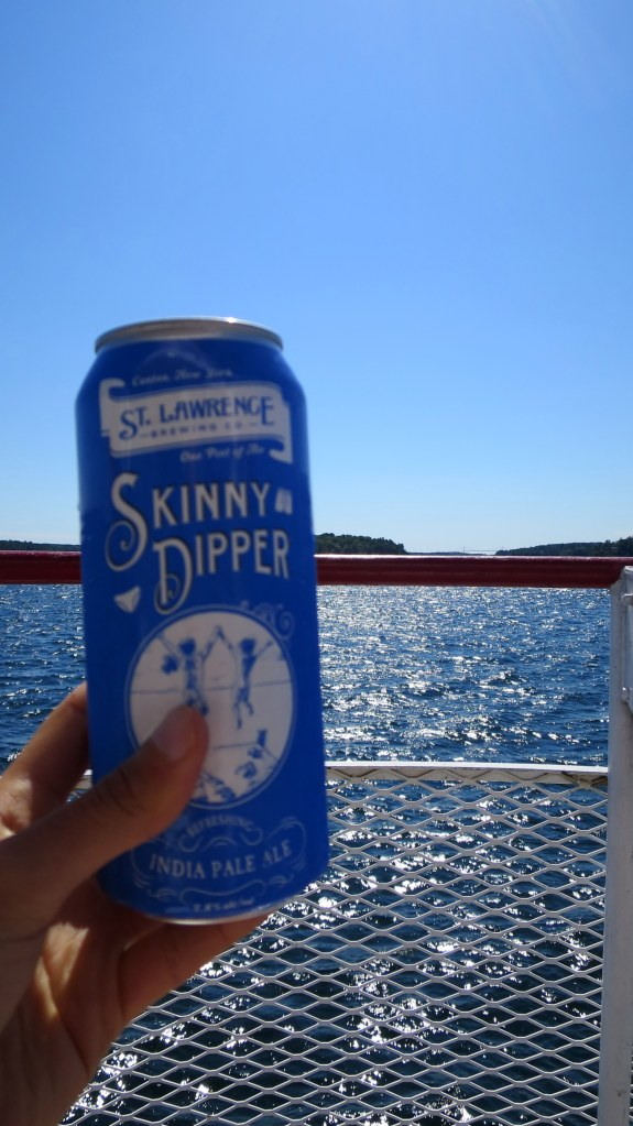 Enjoying a local IPA on deck, Thousand Islands Region, New York and Ontario