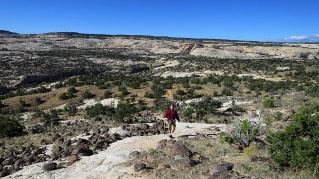 Tom crossing slickrock, Upper Calf Creek Falls Trail, Grand Staircase-Escalante National Monument, Utah