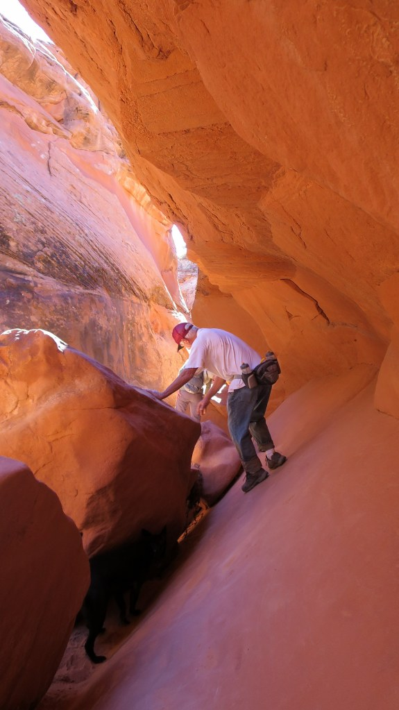 Tom navigating in Spooky Slot Canyon (it should be noted that there's a 15 foot drop below him between the rocks), Hole-in-the-Rock Road, Grand Staircase-Escalante National Monument, Utah