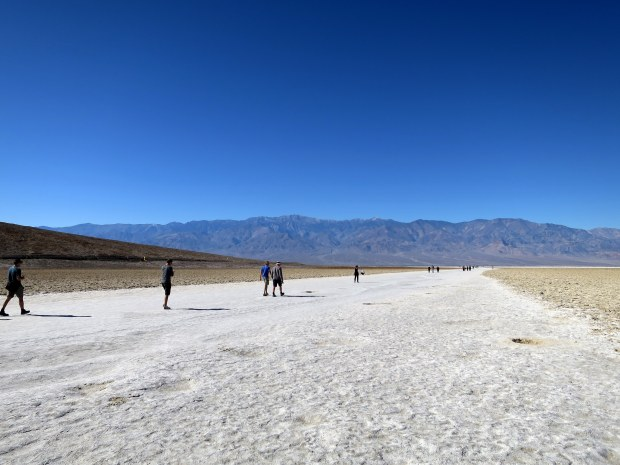 People walking out to the salt flats at Badwater Basin, Death Valley National Park, California