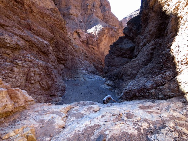Climbing another dry falls, Natural Bridge Canyon, Death Valley National Park, California
