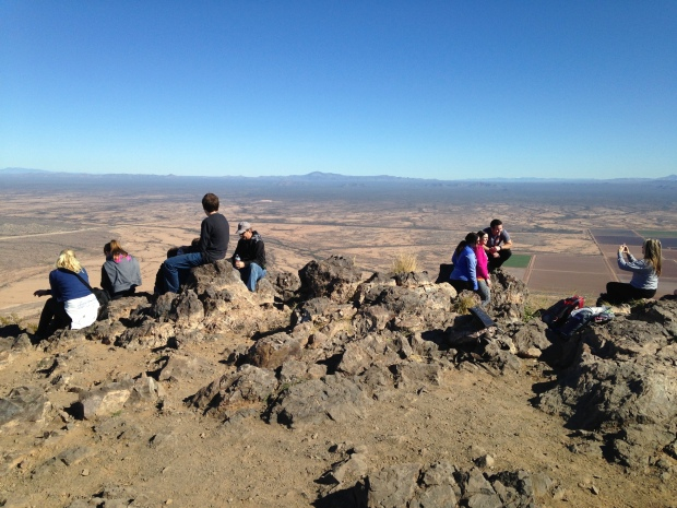 Tom's photo of people sitting and snacking on the peak, Picacho Peak State Park, Arizona