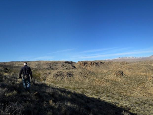 Tom hiking across the hills, Black Rock, Arizona