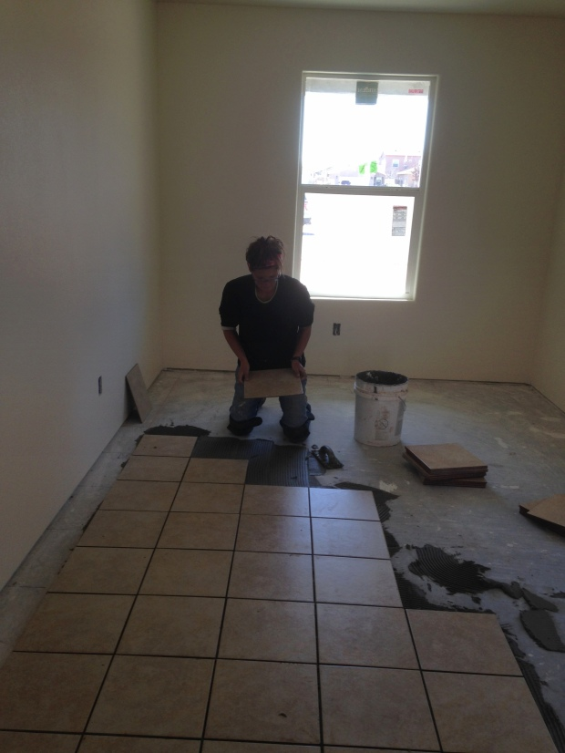 Me tiling House 4, Mesilla Valley Habitat for Humanity, Las Cruces, New Mexico