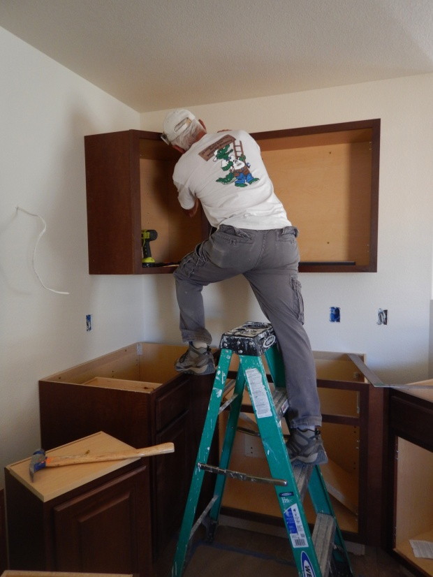 Tom installing upper cabinets, Mesilla Valley Habitat for Humanity, Las Cruces, New Mexico