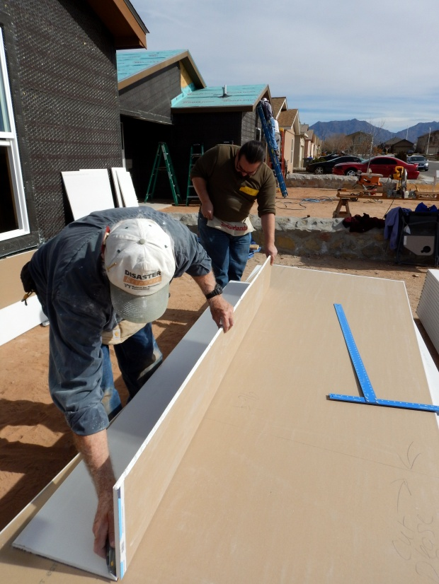 Tony and a day volunteer cutting drywall, Mesilla Valley Habitat for Humanity, Las Cruces, New Mexico