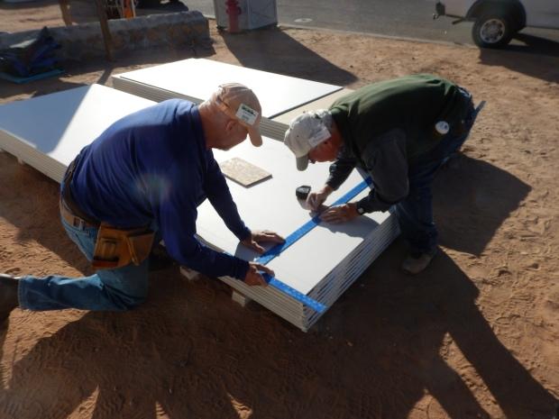 Hans and Tony cutting drywall, Mesilla Valley Habitat for Humanity, Las Cruces, New Mexico