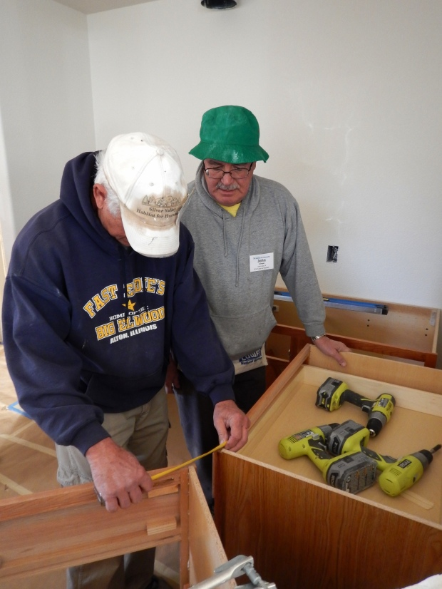 Tom and John installing cabinets in House 1, Mesilla Valley Habitat for Humanity, Las Cruces, New Mexico