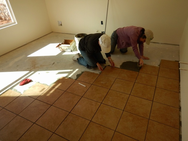 Linda and Loretta tiling the kitchen, Mesilla Valley Habitat for Humanity, Las Cruces, New Mexico