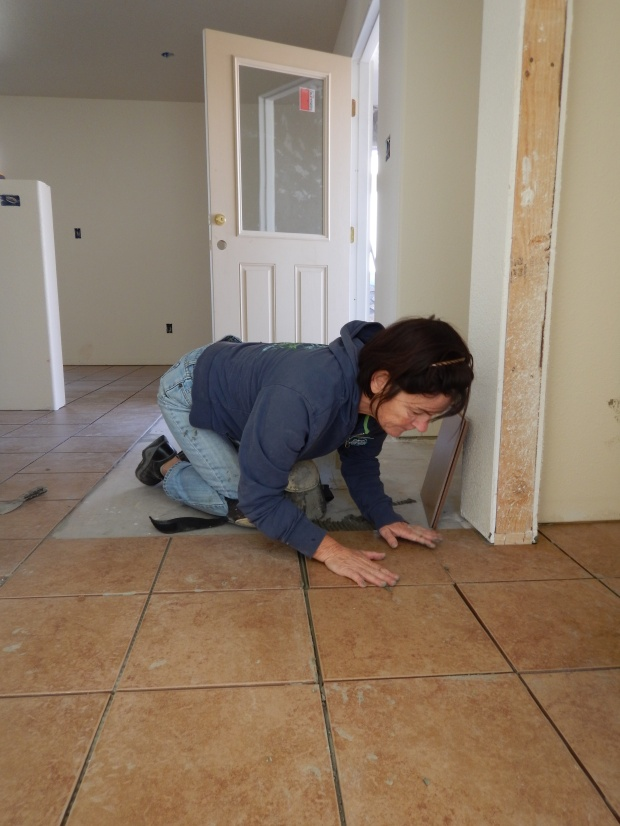 Kathy tiling, Mesilla Valley Habitat for Humanity, Las Cruces, New Mexico