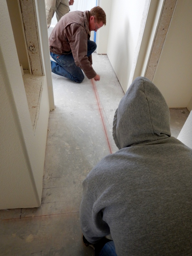 Running chalk lines prior to tiling House 4, Mesilla Valley Habitat for Humanity, Las Cruces, New Mexico