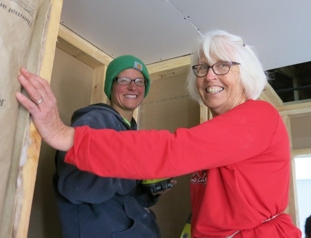 Mary Jo and I putting up drywall, Mesilla Valley Habitat for Humanity, Las Cruces, New Mexico. Photo by Mac Fell.