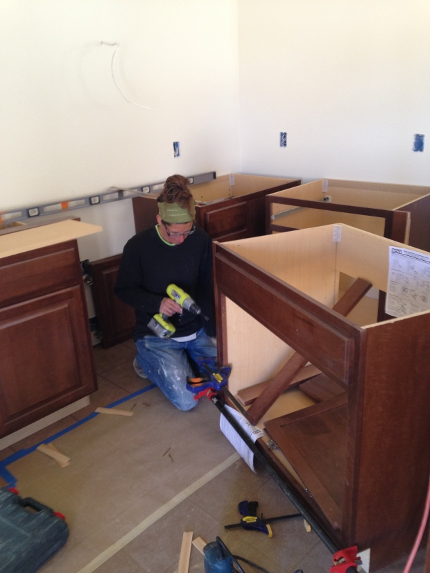 Me screwing spacers onto cabinets, Mesilla Valley Habitat for Humanity, Las Cruces, New Mexico