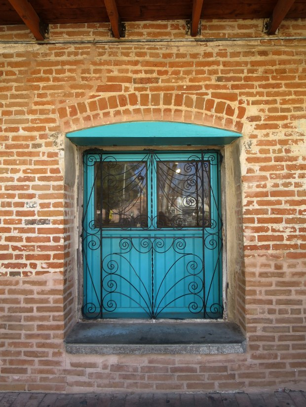 Wrought iron grate over painted window, Old Mesilla, New Mexico