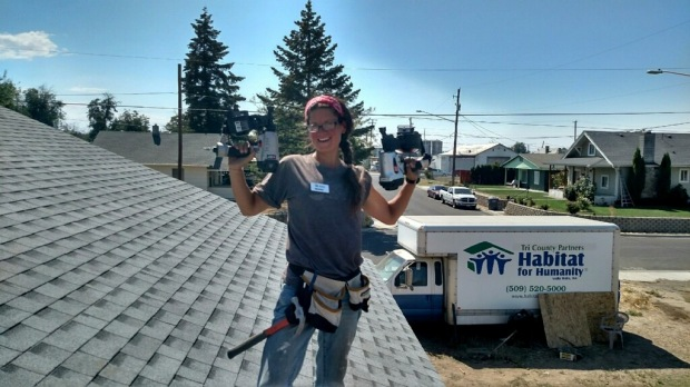 Me showing off my (nail) guns. Just kidding, this was another celebration picture when we had completed shingling and were handing tools down off the roof.