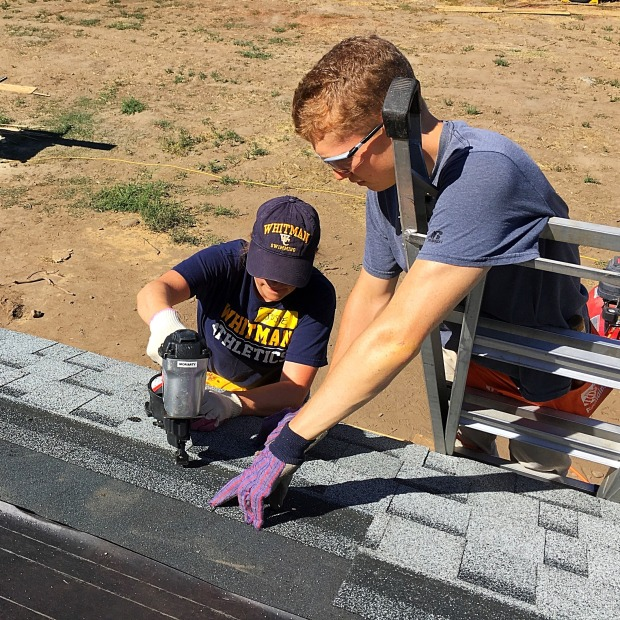 Awesome volunteers Josie and Adam from Whitman College shingling