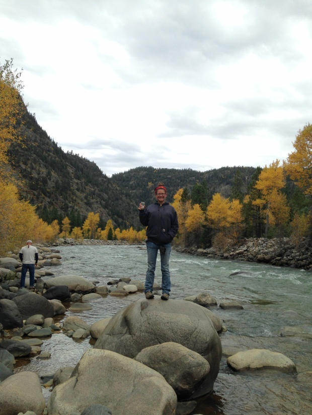 Me exploring the Animas River, beer in hand