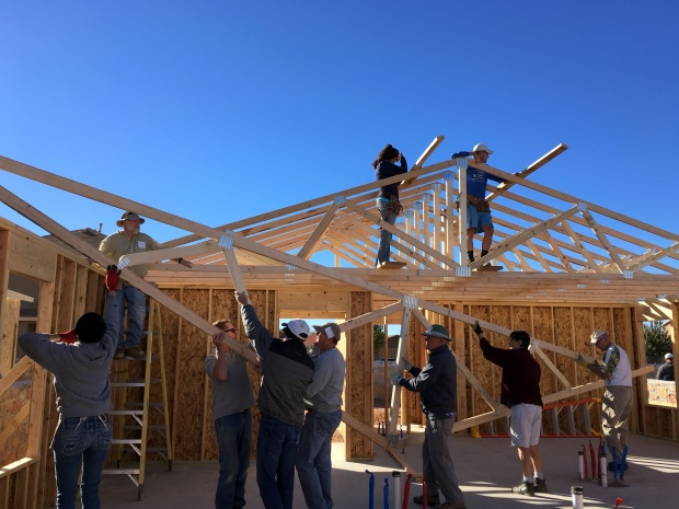 Trusses being carried in