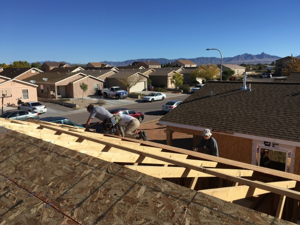 Pete and Kit sheathing the other side of the roof while Tom and I nailed off the decked side