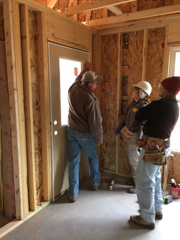 Pete reviewing exterior door installation with Chris and William
