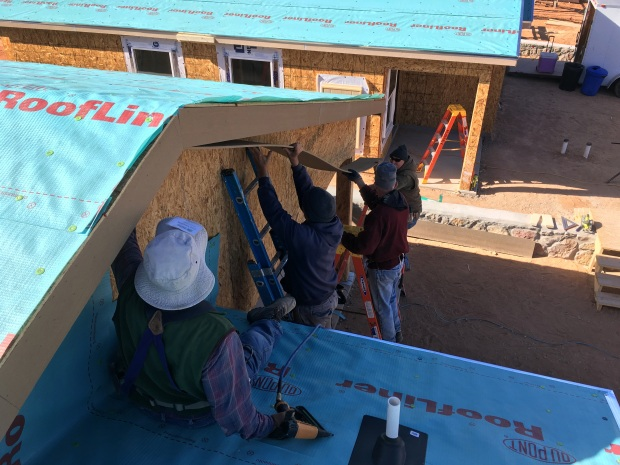 Tony helping Tom, Kit, and Rick put up a long piece of soffit under a front gable