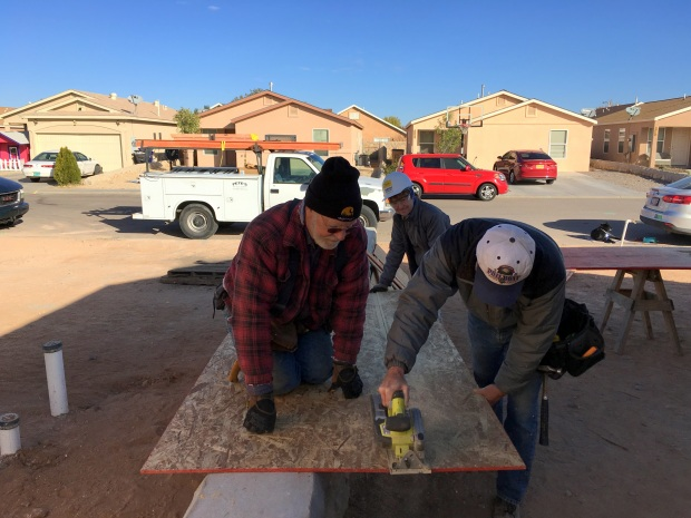 Doug, Tony, and Chris cutting OSB for porch ceilings