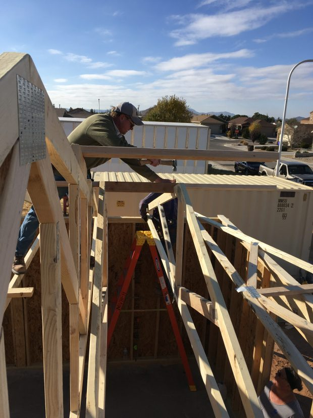 Pete nailing in the next truss to the bracing