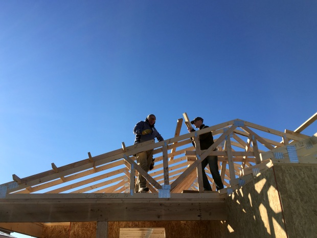 Rick and a volunteer from Souder Miller putting in outlookers