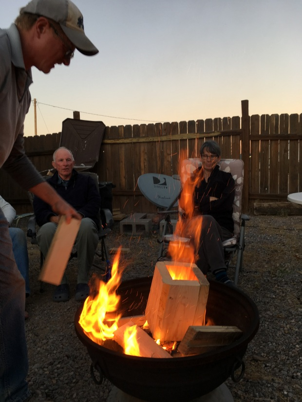 Porch column in the fire pit – how Care-a-Vanners keep warm on chilly evenings