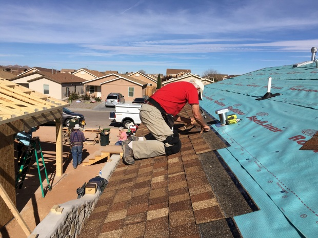 Tom shingling the fourth house