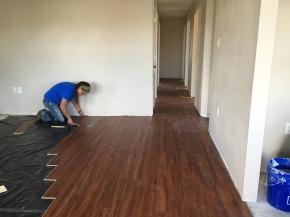 Me installing flooring in the living room