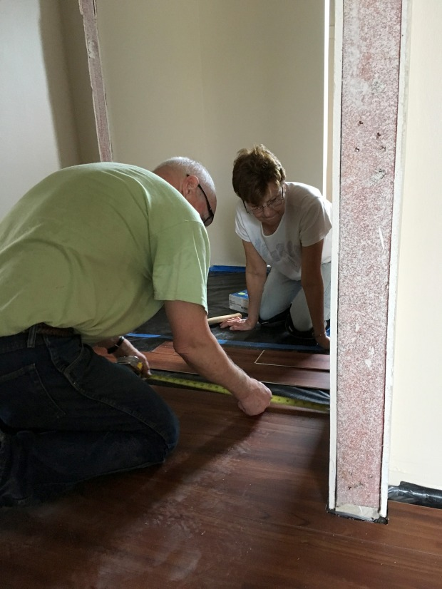 Ken and Carola starting the flooring in one of the bedrooms