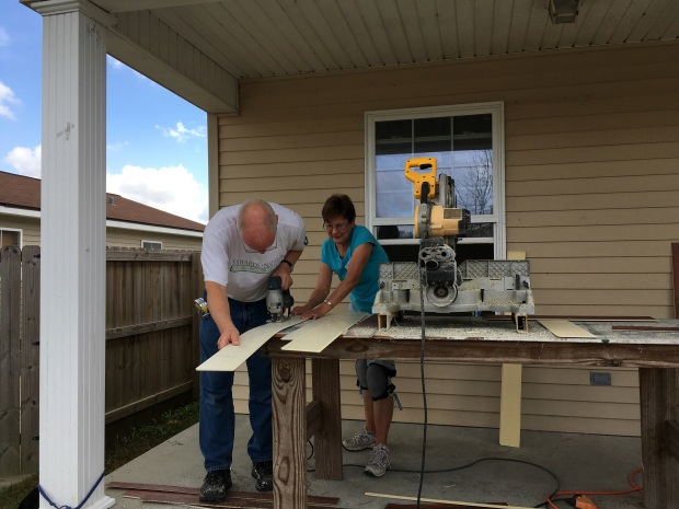 Ken and Carola ripping flooring pieces