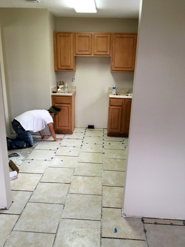 Me tiling the kitchen