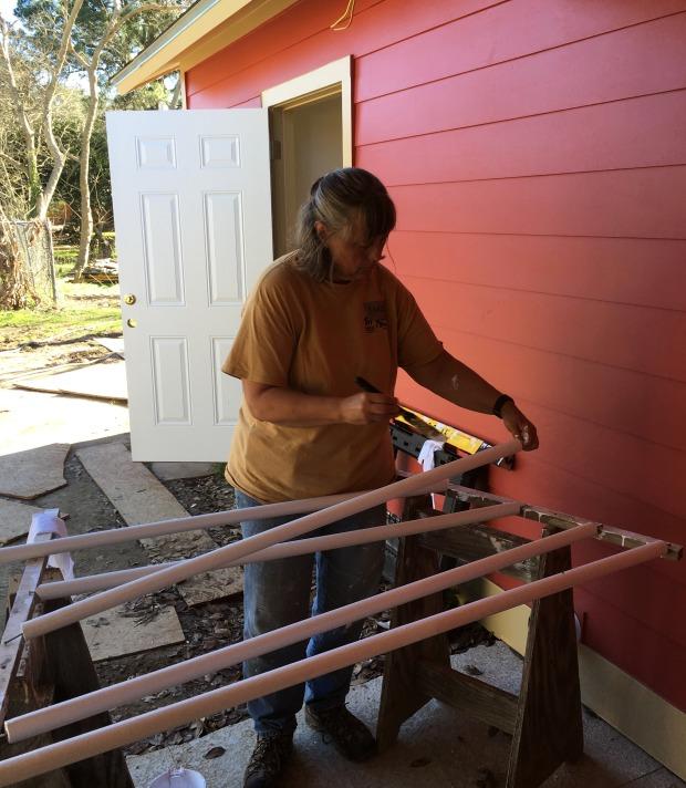 Sandi painting closet poles and shelving