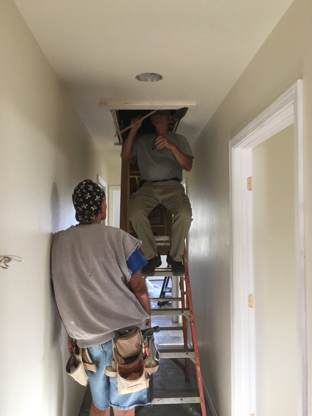 Tom and Wes putting in the attic stairs