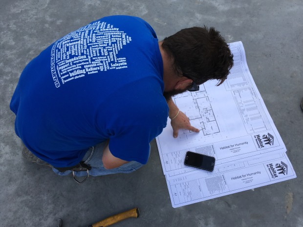 Construction supervisor Matt consulting the plans while we were laying out the slab